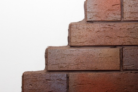 clinker: Detail of a white wall with brown clinker bricks Stock Photo