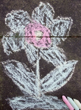 A flower painted with chalk on stone photo