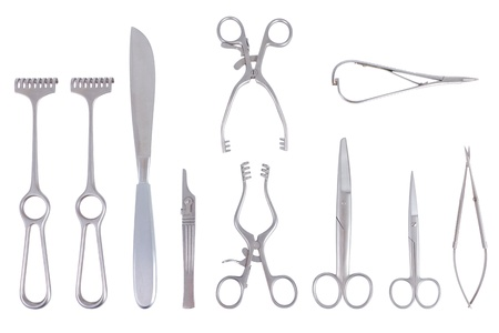 Surgical instruments with different scalpels scissors and spreader over a white background