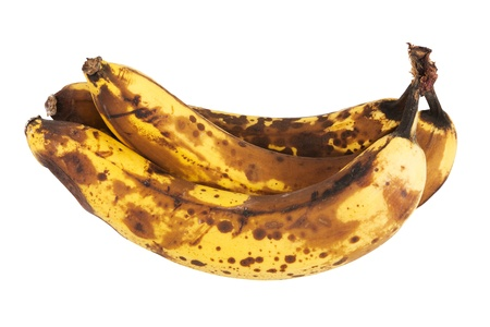 Three old bananas over a white background Stock Photo