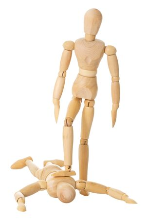 enslave: A wooden doll stands on another lying wooden doll over a white background