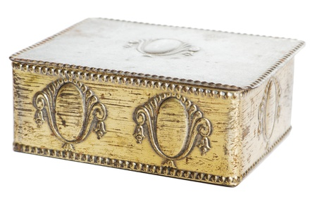 Old brass casket with ornaments over a white background
