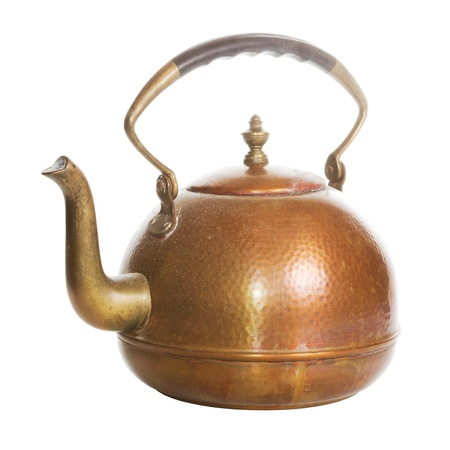 Old copper tea kettle over a white background photo
