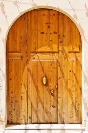 Old brown wooden door of a house entrance photo