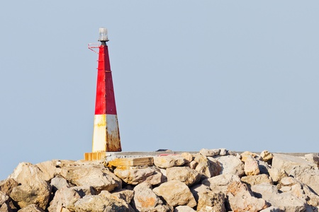 Closeup of a very small lighthouse on the coast Stock Photo - 17894197
