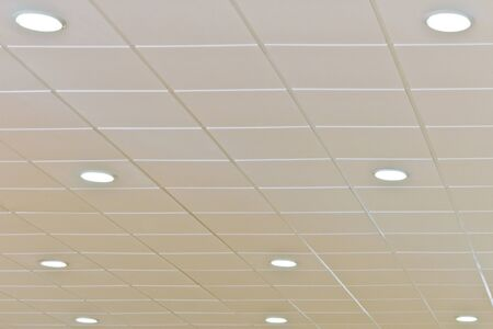 Detail of a white ceiling with integrated lightning photo