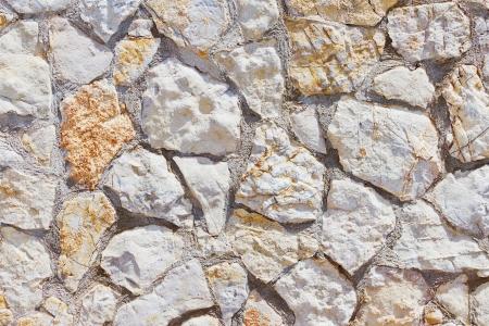 Zusammenfassung Nahaufnahme von einer Mauer mit Natursteinen Standard-Bild - 18438277