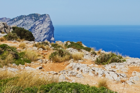 A cliff coast in Mediterranean Sea in Spain in front of a blue sky