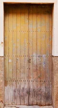 Old brown wooden door of a house entrance