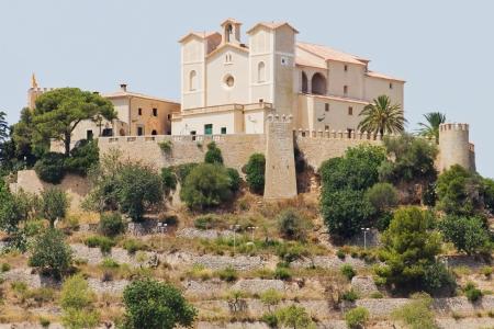 Historical castle with a church in Arta in Majorca Standard-Bild
