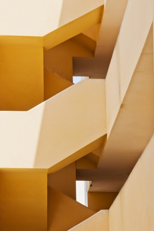 Abstract detail of the architecture of a building with an orange front