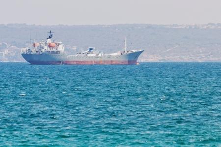 Closeup of a tanker in front of a port in Mediterranean Sea Standard-Bild