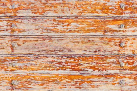 Abstract closeup of old weathered wood with paint