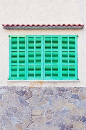 Detail of bright green shutters of a spanish house