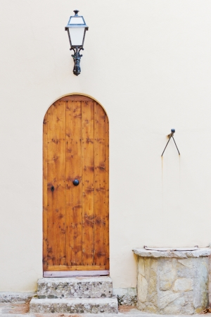 Entrance of a church with a wooden old door Standard-Bild