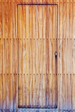 Detail of an old brown wooden door of a house Standard-Bild