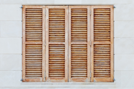 Detail of weathered brown shutters of a spanish house Standard-Bild
