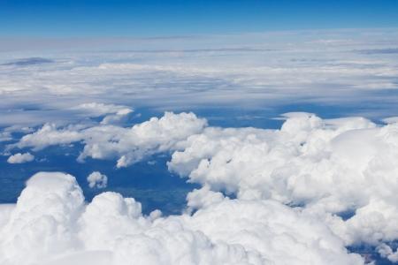 Blue sky over the clouds during flight Standard-Bild