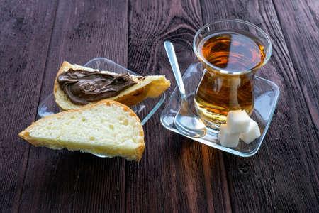 tea and toast wooden table Фото со стока