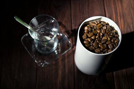 Coffee beans and coffee grinder Фото со стока
