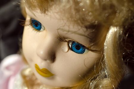 Close up of a doll face. Children's toy doll.