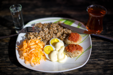 buckwheat with meatballs on the wooden table