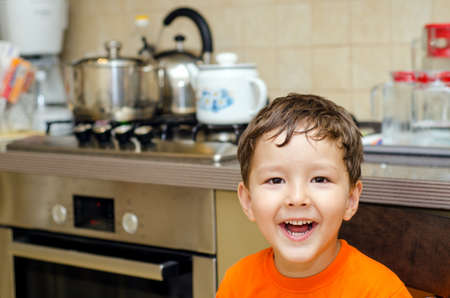 Portrait of a smiling boy in the kitchen Reklamní fotografie