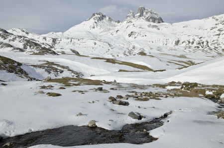 colorectal: Pic du Midi d \  'Ossau in winter from Portalet Pass and the stream source at foreground