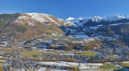 Panorama of Aure Valley in the Hautes Pyrenees in winter, with Saint-Lary-Soulan Village at right, Vignec in left center, Sailhan and are further Top Azet villages, mountain chain is at background Фото со стока