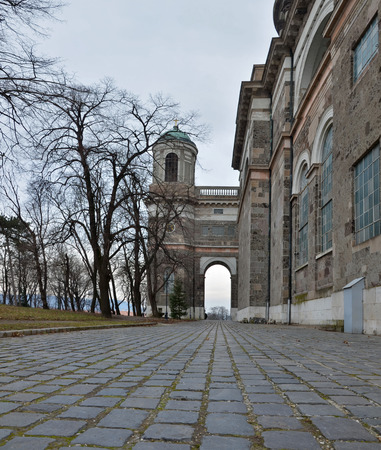 assumed: Cobblestone Walk pass along Esztergom Basilica, famous Primatial Basilica of the Blessed Virgin Mary Assumed Into Heaven and St Adalbert, the biggest building in Hungary. The right arch and the chapel cupola in perspective.