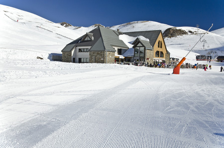 Le Vallon restoration area at Saint Lary Soulan ski resort snow textured surface area of ??area od the ski slope is at foreground