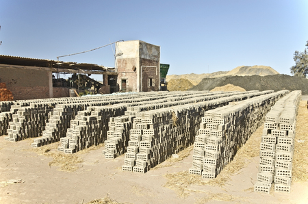 brig: Fresh rectangular clay stone brick Arranged for drying under the sun In the manufacturing After building brick factory in Egypt Stock Photo