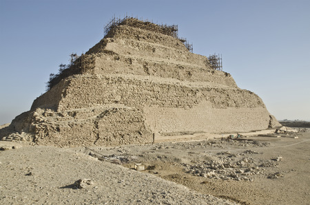 djoser: The first Egyptian Pharaoh Djoser Pyramid of 27 th century BC is Situated in the necropolis of Saqqara, ict stepped pyramid, Actually at restoration, Archeological plant is at foreground