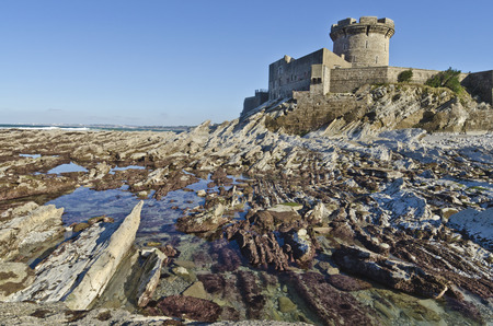 Fort of Socoa, a 15th-century fortress built by Louis XIII, seen from rocks of the Atlantic Ocean cost at low tide, Basque Country, Aquitaine, France Stock Photo - 36486853
