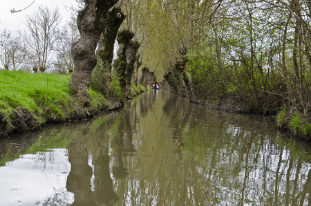 Marais Poitevin raw channel for boating and canoeing with Flatboat Vendee Pays de la Loire. France. Water channels Surrounded with green vegetation