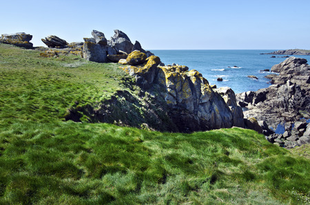 vendee: Panorama of Wild Rocky Coastline in SouthEast of Yeu Island with green grass at foreground. France Vendee Pay loire