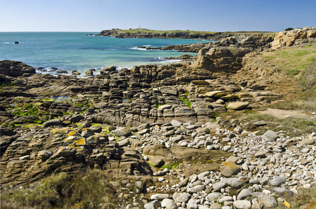 vendee: Its landscape of the Wild Rocky Coastline in SouthEast of Yeu Island with textured stones at foreground. France Vendee Pay loire