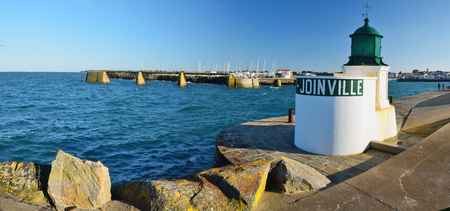 vendee: The turret of the harbor entrance in Joinville in Yeu Island with yacht harbor and town harbor at background. France Vendee Pay loire