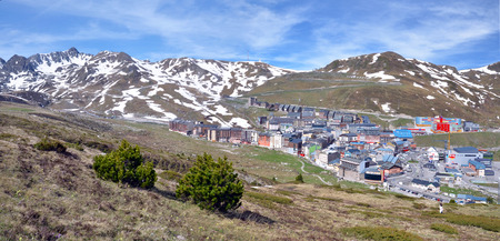 pas: Its the Landscape of Pyrenees Mountains in the border of France and Andorra with the cityscape of Pas de la Casa ski resort and shopping instead Andorran town in spring.