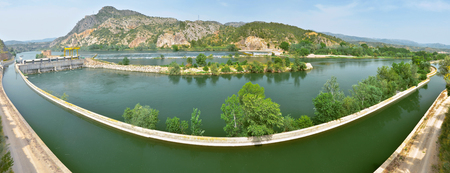 hydraulics: Panorama of Ebro river at Cherta Presa gold Assud Xerta in Catalan this weir is a monument of hydraulics engineering and cultural heritage of Spain. Stock Photo