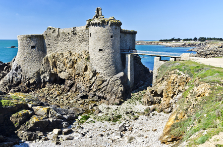vendee: Ruins of old medieval castle of the Isle of Yeu make apart of wild coastline of Yeu Island in South Atlantic ocean is at left background. France Vendee Pay loire