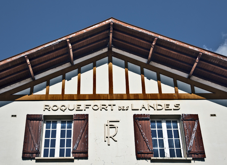 The name of Roquefort des Landes town marked in ancient traditional building of postal office, Aquitaine, France