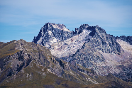 flank: Western flank of Peaks Balaitous 3144 at left and Frondellas 3063 m at right seen from Vertice d Anayet. its a granitic massif of Pyrenees, located right on the border between Spain and France