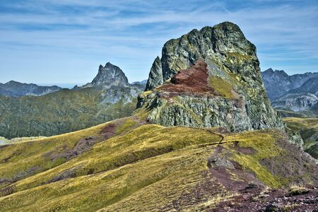 vertices: Peak Anayet 2575 m in Spanish Aragon and peak Midi d Ossau 2807 m in French Bearn seen from Vertice d Anayet 2559 m in Pyrenees mountains Stock Photo