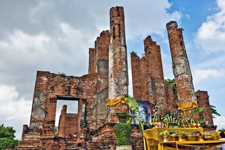 brig: Ruins of Royal Sermon Hole or Vihara, in Ayutthaya Wat Thammikart temple, the worship place with offerings to Buddha is at right foreground.