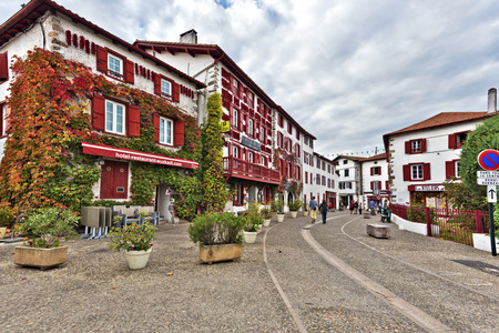 Espelette, France, November 1, 2015 Espelette town in French Basque country, house walls are traditionally decorated with Red Pappers. Basque province of Labourd, Atlantic Pyrenees, Aquitaine, France Editorial