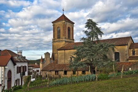 basque woman: Church of Notre-Dame-de-l-Assomption in La Bastide-Clairence village in Lower Navarre Province of French Basque country, Atlantic Pyrenees, Aquitaine, France, listed amount the most beautiful villages of France