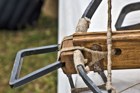 arbalest: Arming hand and wooden holder of medieval crossbow