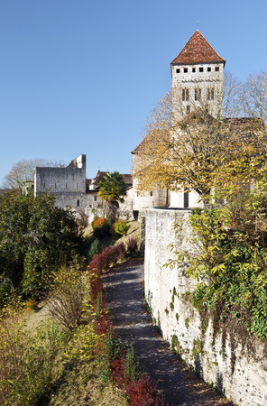 the french way: Medieval church Saint-Andre village and descent to Gave Oloron river. Bearn, Atlantic Pyrenees, France