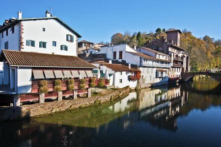 basque woman: Historical part of Saint-Jean-Pied-de-Port seen from Nive River, situating in Pilgrimage Road to Santiago de Compostela, Basque country, Atlantic Pyrenees, France